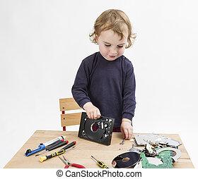 computer parts on wooden desk - preschooler with computer...