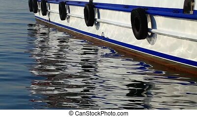 Ferryboat and reflection on water