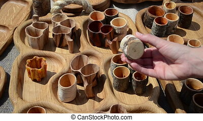 hand wooden buttons fair - hand takes natural wood...