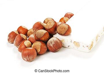 nougat and hazelnuts - Sweet nougat with hazelnuts isolated...