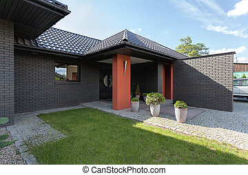 Entrance to a modern luxury house with brick wall