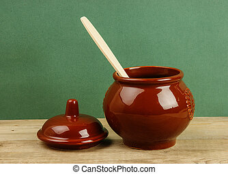 ceramic pot with a wooden spoon old desk