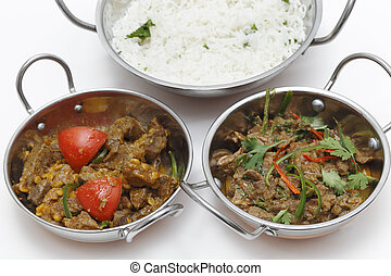 Lamb curries and rice - A bowl of spiced lamb curry with...