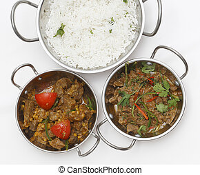 Lamb curries and rice from above - A bowl of spiced lamb...