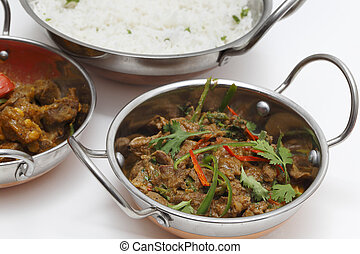lamb curry night - A bowl of spiced lamb curry with...