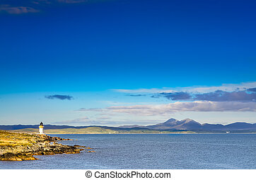 Ocean coast lighthouse in Port Charlotte, Scotland