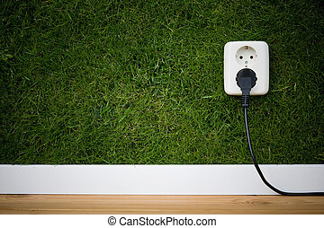 green energy - energy concept outllet in grass