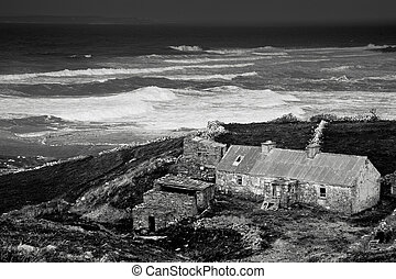 west coast ireland :Dingle - coast view with old cottage...