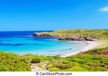 Platja del Tortuga beach in sunny day at Menorca island,...