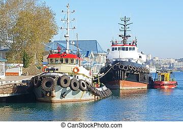 A tug boat - tug boats  in the port in Sevastopol town