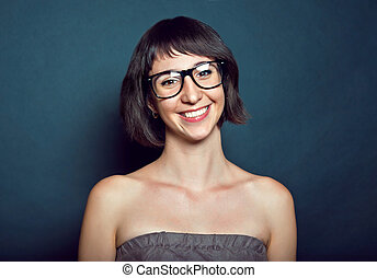 portrait of a beautiful young girl in glasses