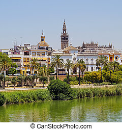 Guadalquivir River in Seville - View of Seville and...