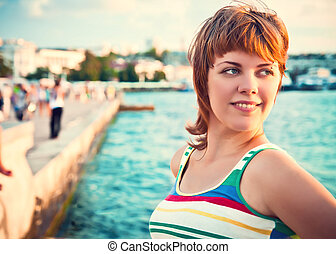 portrait of a smiling young beautiful girl on the beach