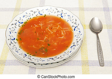 Tomato soup with noodles and parsley
