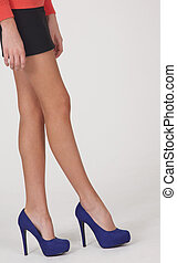 Black Mini Skirt and Blue Heels - Woman's Legs Wearing a...