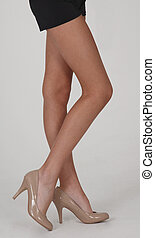 Black Mini Skirt and Beige Heels - Woman's Legs Wearing a...