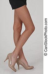 Black Mini Skirt and Beige Heels - Womans Legs Wearing a...