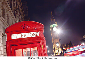 Red Telephone Booth and Big Ben in London street at night