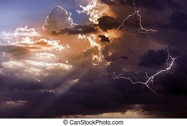 Beautiful Storm During Sunset. Lightnings Between Clouds...