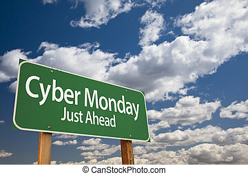 Cyber Monday Just Ahead Green Road Sign and Clouds