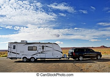 RV Trailer Journey Travel Trailer Pulling by Large Sport...