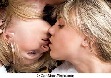 Portrait of the two kissing young women. Isolated