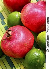 Pomegranate Limes - Pomegranate and Limes Closeup Tabletop...