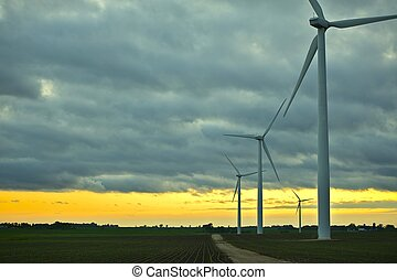Wind Generators Sunset. Wind Turbines Plantation. Technology...
