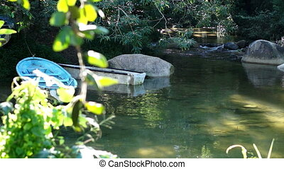 Boats on a Tranquil River Scene Dol - Scenic dolly shot of...