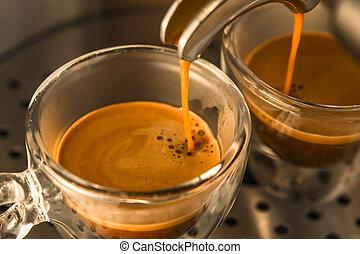 mainstream of strong espresso coffee from a espresso machine...