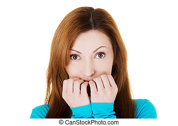 Attractive casual woman expressing fear worries Isolated on...
