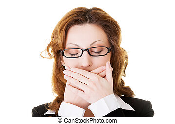Attractive business woman with hands on her mouth Isolated...