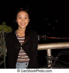 Young Lady on the bridge With Loi Krathong Festival