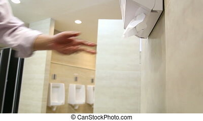 Office man drying hands