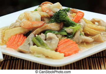 yellow noodle with in a creamy gravy sauce - Stir fried...