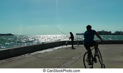 Fisherman and bicycle man