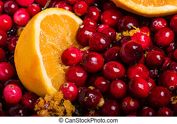 Cranberries and orange making cranberry sauce - Cranberries...