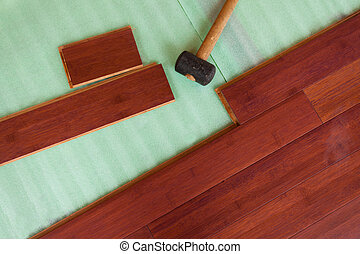 Wooden bamboo hardwood flooring planks being layed - Home...