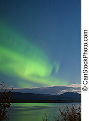 Moon-lit clouds northern lights over Lake Laberge - Green...