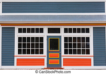Small store front entrance colorful wooden house -...