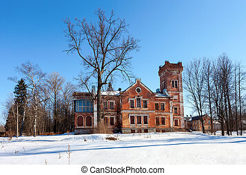 Old brick building on a winter day in Borovichi, Russia