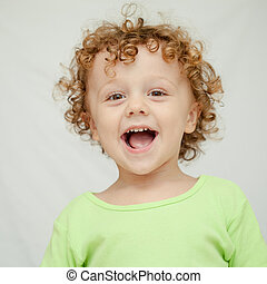 Portrait of joyful little boy