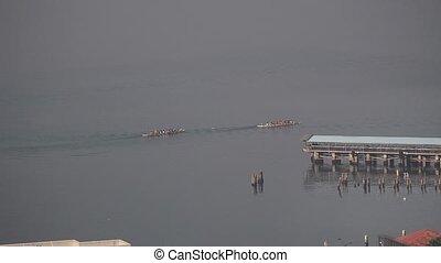 boat rowers in the ocean