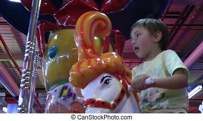 Boy on Merry go round