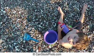 Boy Playing with toys on the beach