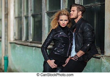 young fashion woman standing near her lover, outdoor picture...