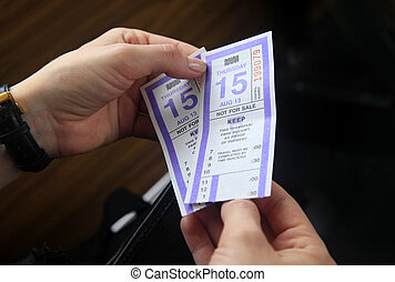 Bus Tickets - Two bus ticket in female hands