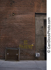 "No Parking - Downtown Alley featuring a ""No Parking\"" spray..."