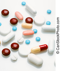spread group of pills on white background