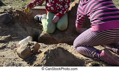 girls sandbox dig - colorfully dressed girls sandbox digs...